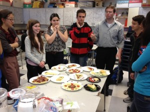 French teacher James Curly samples a crepe made by one of his students. Students in Curly's French 4 Honors class made different types of French food on Mar. 14.